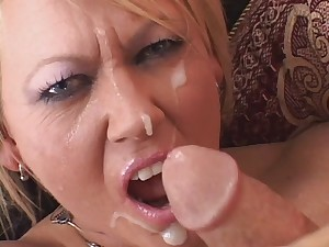 Older golden-haired floozy grasps and pulls on a studs difficult thick dick