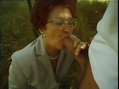 Granny Susanne Sucks and Copulates Outdoors